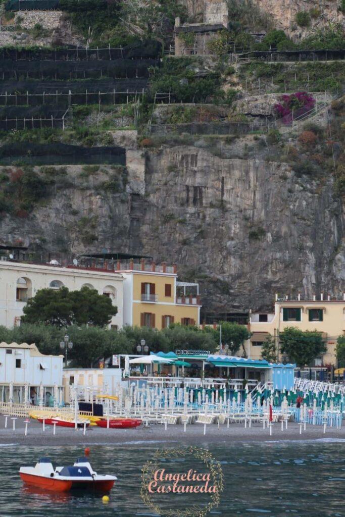 Public Beach on the Amalfi Coast while closed with beach umbrellas folded.